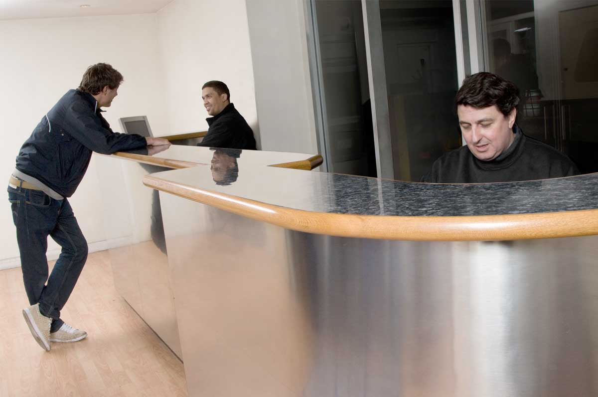 Universal front desk with a staff member talking to a customer